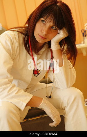 Doctor having a short pause between work - Stock Photo