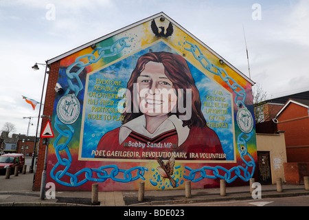 IRELAND, North, Belfast, West, Falls Road, Mural of Bobby Sands on the gable end of the Sinn Fein headquarters. - Stock Photo