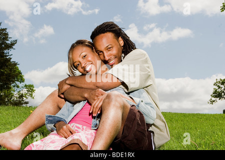 Beautiful young couple enjoying each others company - Stock Photo