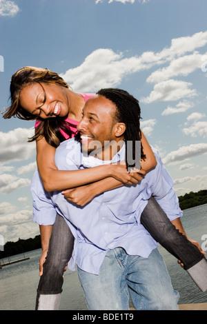 Beautiful young couple enjoying each others company - Stock Photo