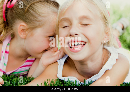 Girls sharing secrets. - Stock Photo