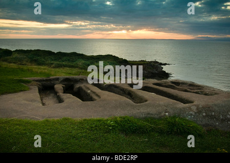 Stone Graves, St Patricks chapel, Heysham Head, Lancashire at sunset - Stock Photo