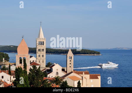 View of Rab Town with Bell Towers (Campaniles) of St Justine's Church, St Mary's Cathedral, and St Andrew's Monastery, - Stock Photo