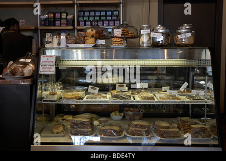 Display case of food, lunch, sandwiches, cookies, pastry, dessert in coffee shop. - Stock Photo