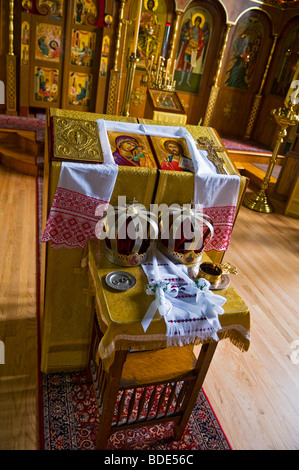 Crown hats and rings before the start of a  russian orthodox wedding - Stock Photo