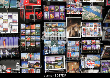 postcards of london on display outside a souvenir shop london uk - Stock Photo