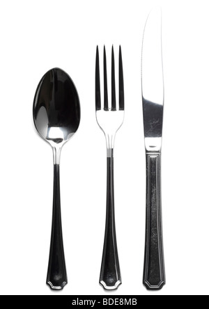 Old knife, fork and dessert spoon on white background - Stock Photo