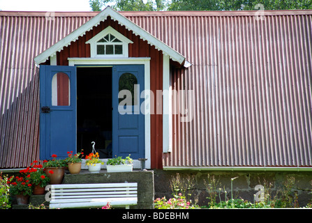 Barn in a garden - Stock Photo