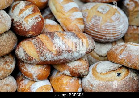 Shop display of rustic artisan bread - Stock Photo