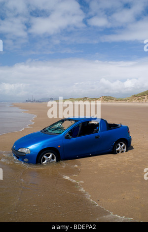 stolen car abandoned on kenfig beach port talbot south wales - Stock Photo