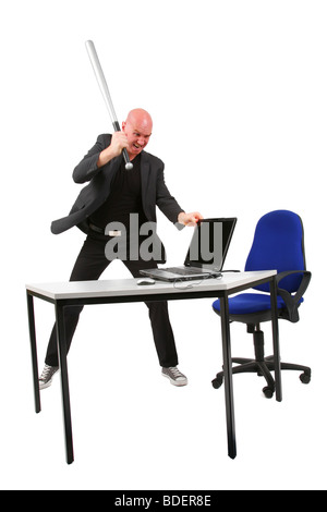 bald headed man striking with baseball bat at a laptop - Stock Photo