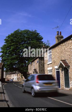 car driving through quiet village near Leeds Yorkshire UK - Stock Photo