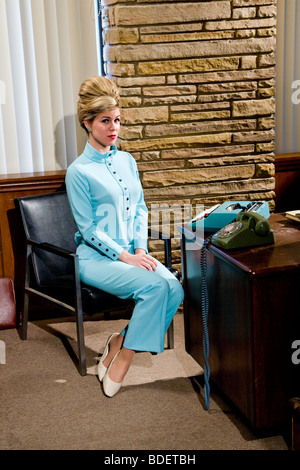 Vintage portrait of businessman and female assistant in office - Stock Photo