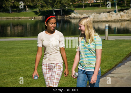 Racially mixed mix Ethnic diversity Two girls hang hanging out together  Hispanic and Caucasian junior high girls - Stock Photo