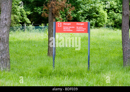 A sign warning of unexploded WW I ammunition - Stock Photo