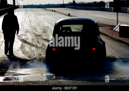 Drag car at start of run on drag strip - Stock Photo