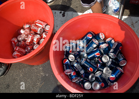 Cans of ice cold Coca-Cola and Pepsi-Cola are kept in separate containers at a street fair in New York - Stock Photo