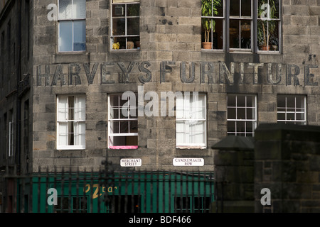 The original sign for Harvey's Furniture Store still visible on the stonework of the building in Edinburgh. View - Stock Photo
