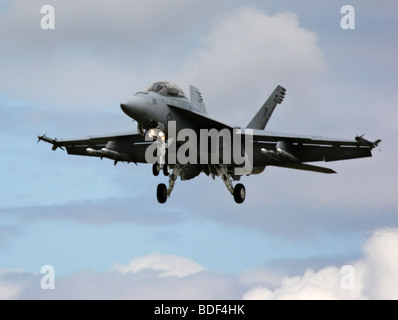 American Boeing FA-18 Super Hornet Jet landing with dynamic cloud background at the Farnborough Air Show in 2008 - Stock Photo