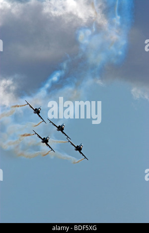 A formation of four BAE Hawk jets approaching at a low altitude - Stock Photo