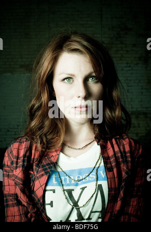 Red head woman looking into camera attentively. - Stock Photo