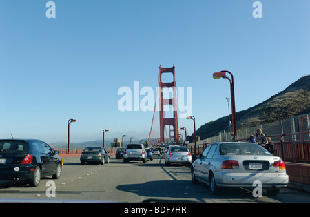 View of the Golden Gate Bridge while crossing it. - Stock Photo