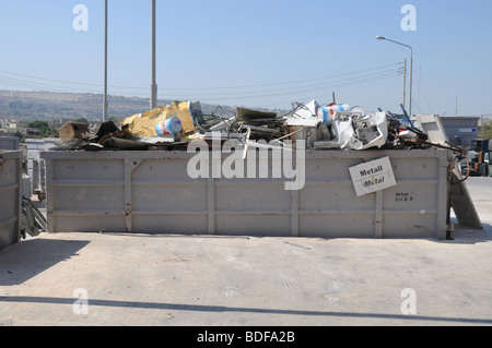 A section in a civic amenity site where metal scrap is source separated and disposed for recycling. Waste management - Stock Photo