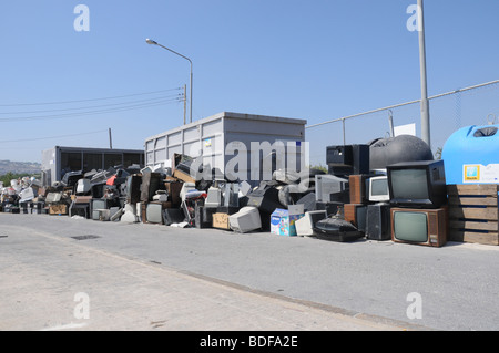 A section in a civic amenity site where used tyres and electrical appliances are disposed for recycling. - Stock Photo