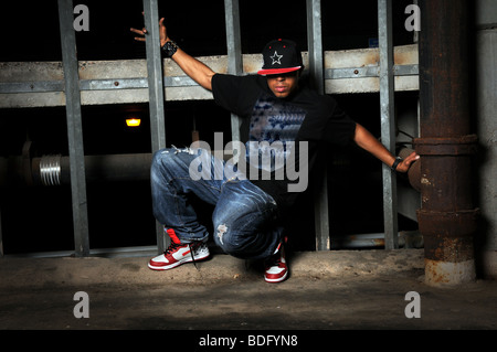 African American hip hop dancer performing in old building - Stock Photo