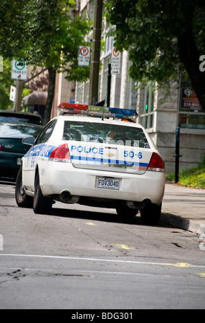 A Canadian police car parked on a road in Montreal, Quebec - Stock Photo