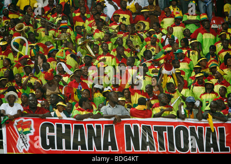 Crowd scenes of Ghanian supporters displaying enormous Ghana national flag. Ghana V Morocco. African Cup of Nations - Stock Photo
