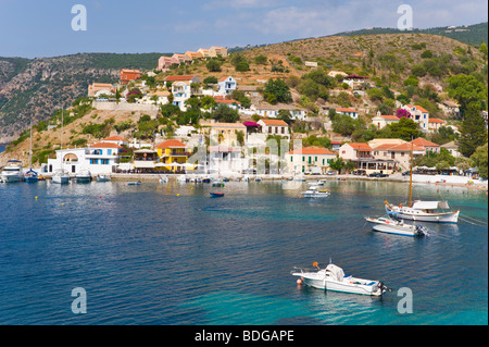 View over harbour with yachts, pleasure, leisure and local fishing boats at Assos on the Greek island of Kefalonia - Stock Photo