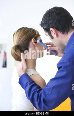 EAR NOSE & THROAT, WOMAN - Stock Photo