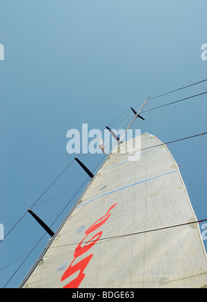 man up mast seeing to sail on boat - Stock Photo