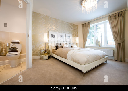 Double bed in bedroom decorated in neutral tones with for Beautifully decorated beds
