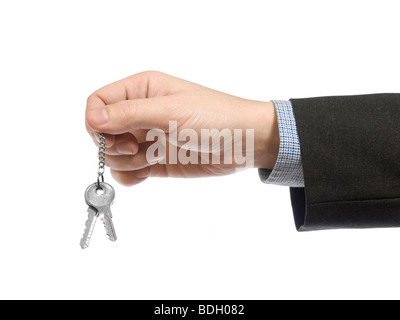 A business man holding a set of keys. - Stock Photo