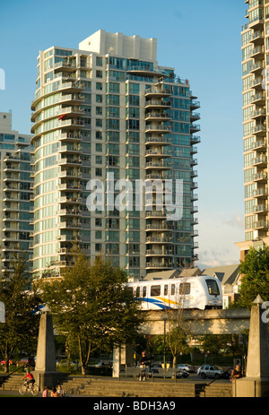 Vancouver Condominium Towers with the Skytrain in the foreground. Vancouver BC, Canada - Stock Photo