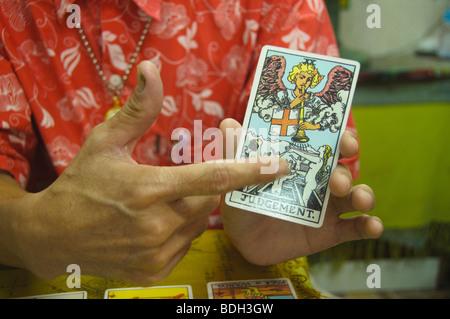 fortune teller in Bangkok Thailand giving a tarot card reading - Stock Photo