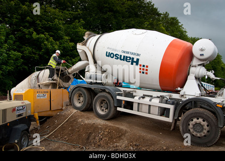 Cement lorry delivering to building site - Stock Photo