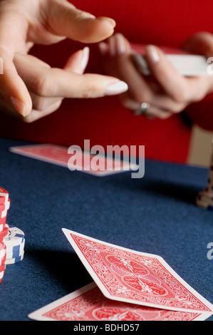 Woman dealing cards - Stock Photo