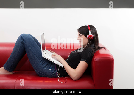 mid adult woman listening to music at home. Copy space - Stock Photo