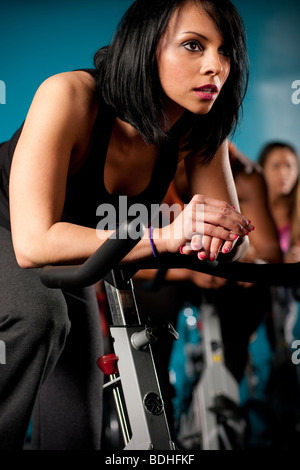 A group of people working out during a Spinning class at Crunch Gym in Hollywood, California, January 21, 2008. - Stock Photo
