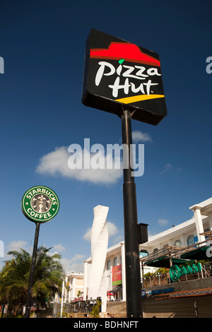 Indonesia, Bali, Kuta, Jalan Kartika Plaza, Pizza Hut and Starbucks Coffee signs