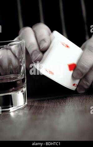 Man shuffling deck of cards - Stock Photo