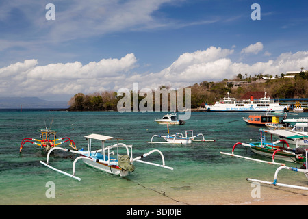 Indonesia, Bali, Padangbai, colourfully painted outrigger fishing boats moored on the bay - Stock Photo