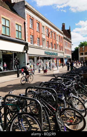 Bicycles parked in Sidney Street in the city centre, Cambridge England UK - Stock Photo