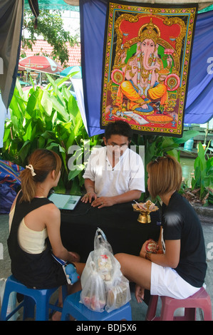 fortune teller in Bangkok Thailand giving a reading - Stock Photo