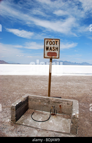 Foot Wash sign and water hose at Bonneville Salt Flats, Utah, USA - Stock Photo