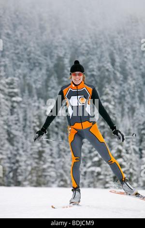 Woman Cross Country Skiing, Whistler, British Columbia, Canada - Stock Photo