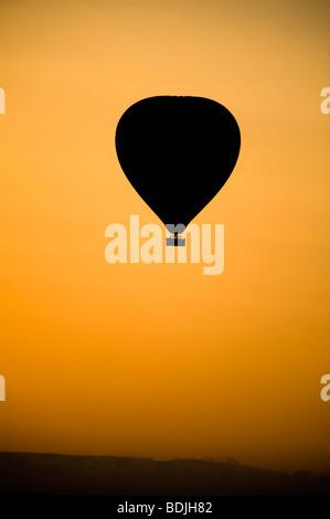 Hot Air Balloon at Sunrise, Masai Mara, Kenya - Stock Photo